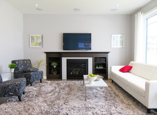 TV Hanging Above Fireplace In Modern Living Room