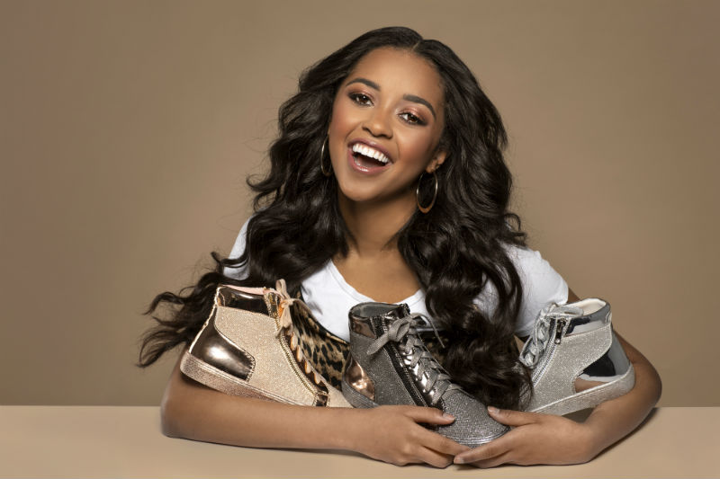Pretty Dark Haired Girl Smiling With Glitter Sneakers