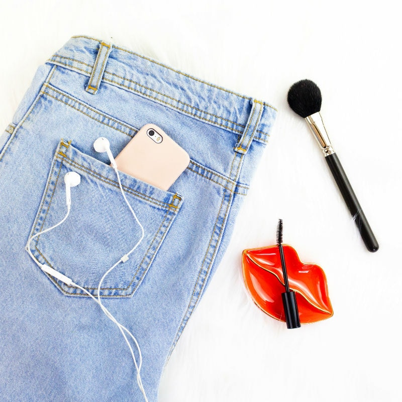 Denim Jeans With Gold iphone and Makeup Tools