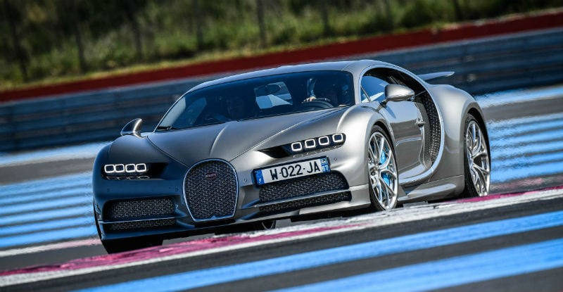 Silver and Blue Bugatti Chiron On Racetrack
