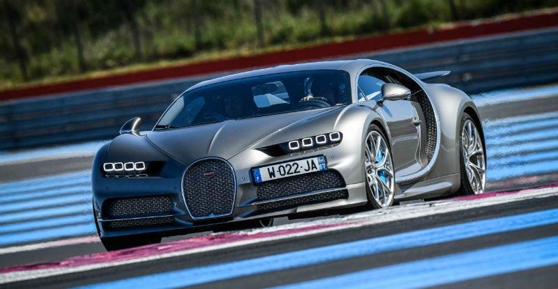 Silver and Blue Bugatti Chiron On Racetrack