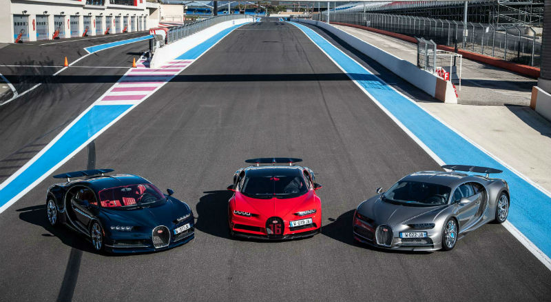 Silver, Red, and Black Bugatti Chiron On The Racetrack